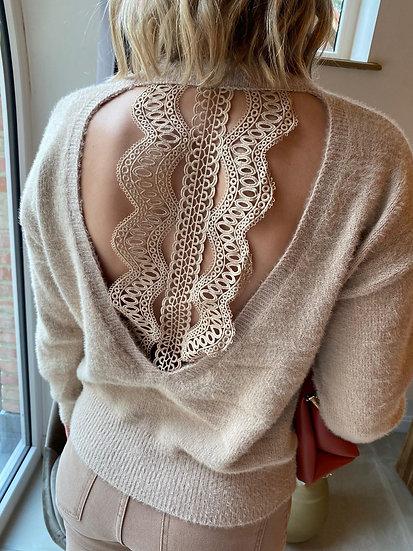 beige trui met open rug
