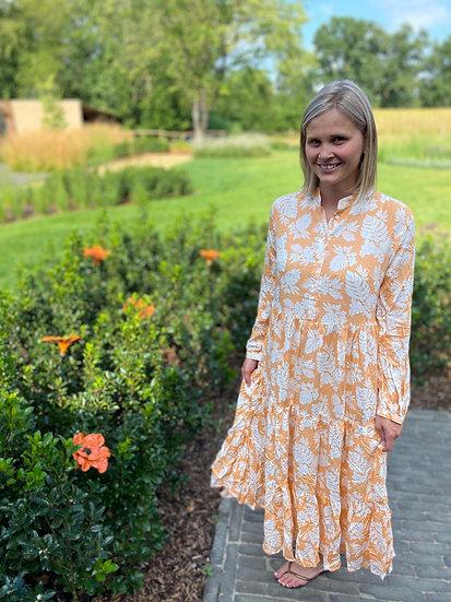 Oranje/wit bloemenkleed met lange mouwen