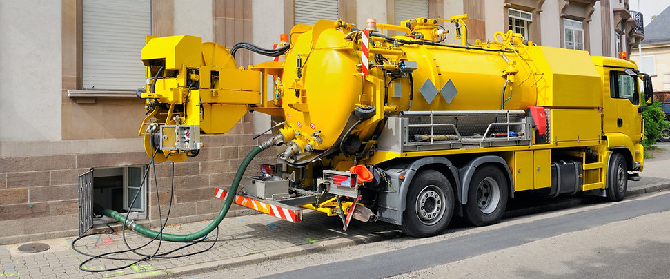 Sewage truck on city street in working p