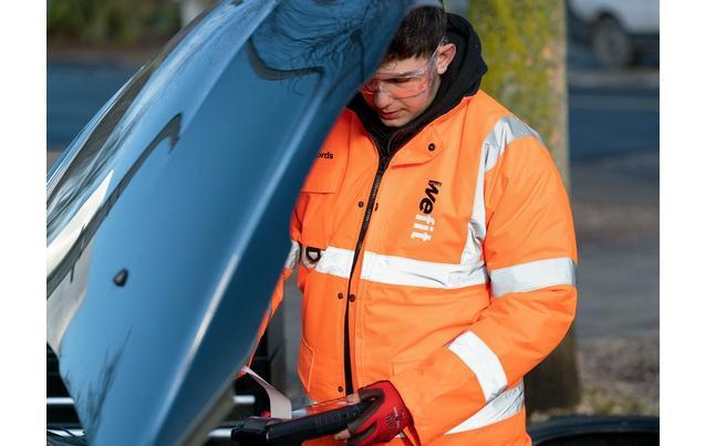 Technican checking under car bonnet