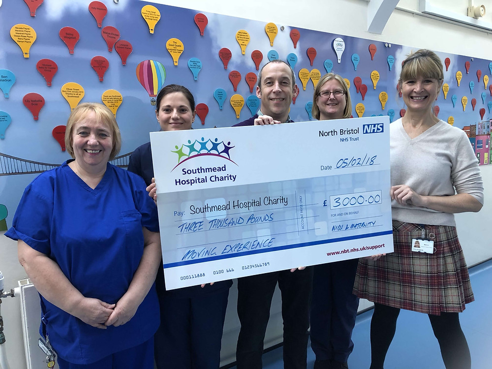 Matt Colley, director of Community Mortgage Company with cheque for Southmead Hospital charity