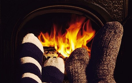 Family with feet in front of fire