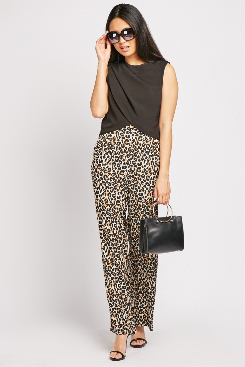 Model wears leopard print, wide legged trousers for £5