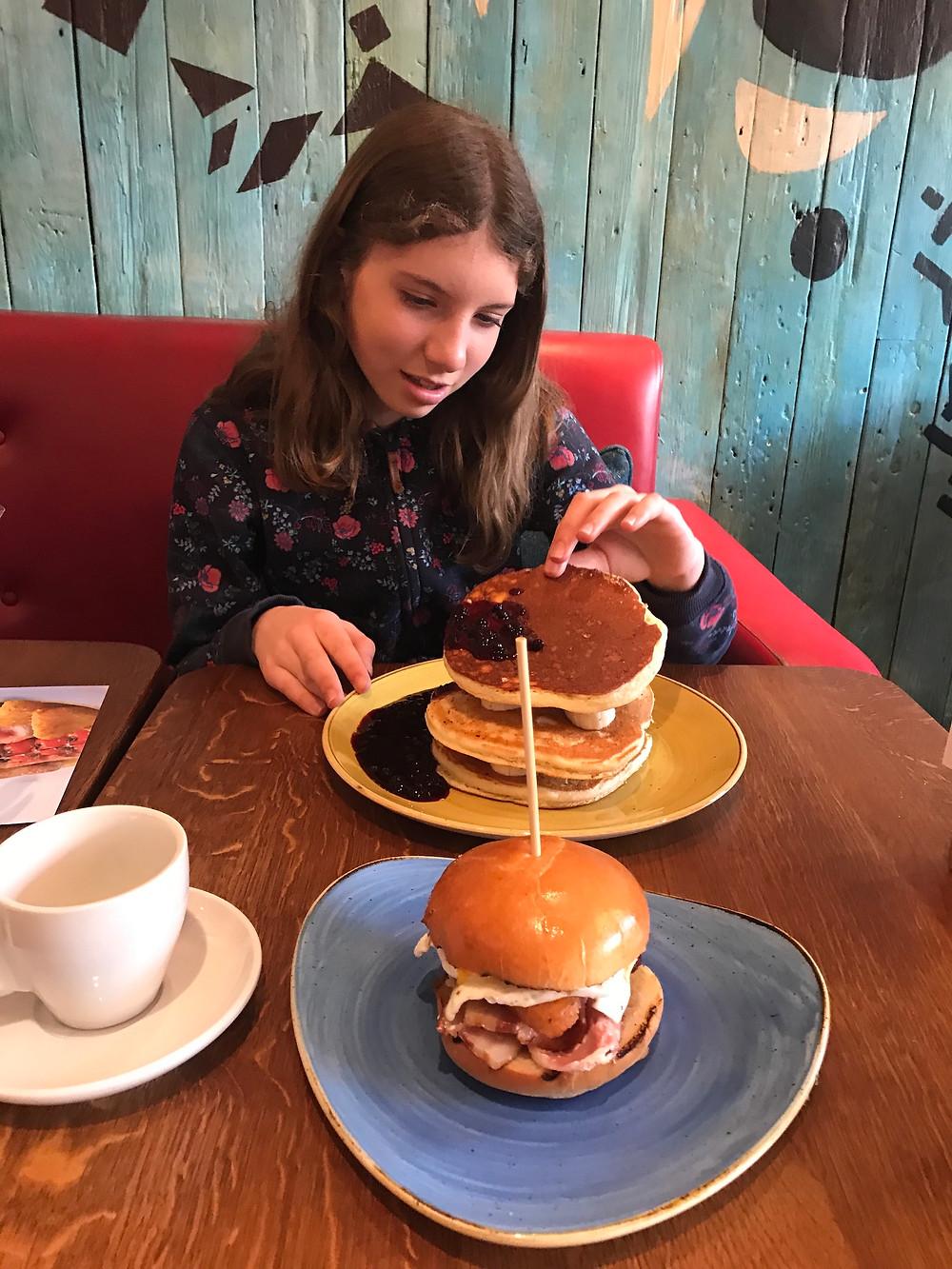 Little Miss Diva enjoying pancakes at Giraffe.