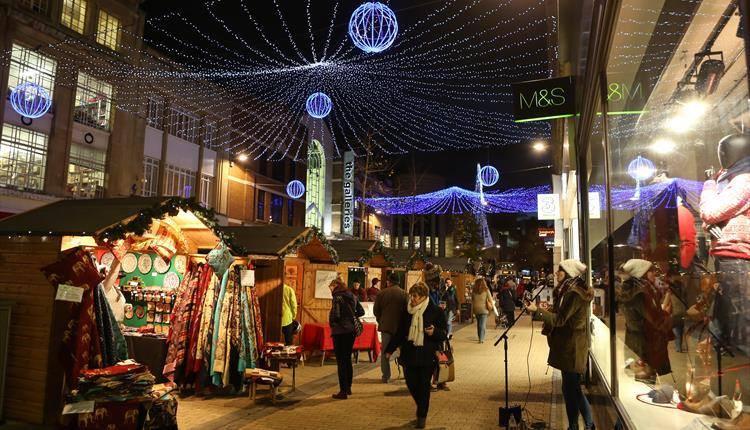 People shopping at Bristol Christmas market