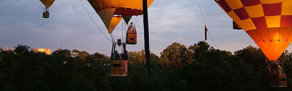 Photo of balloons in the sky by Luke Jarram