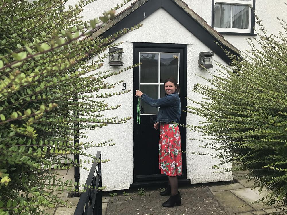 Woman with keys to open front door