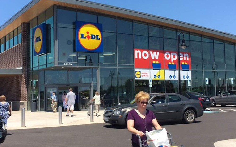 Woman pushing a trolley outside Lidl