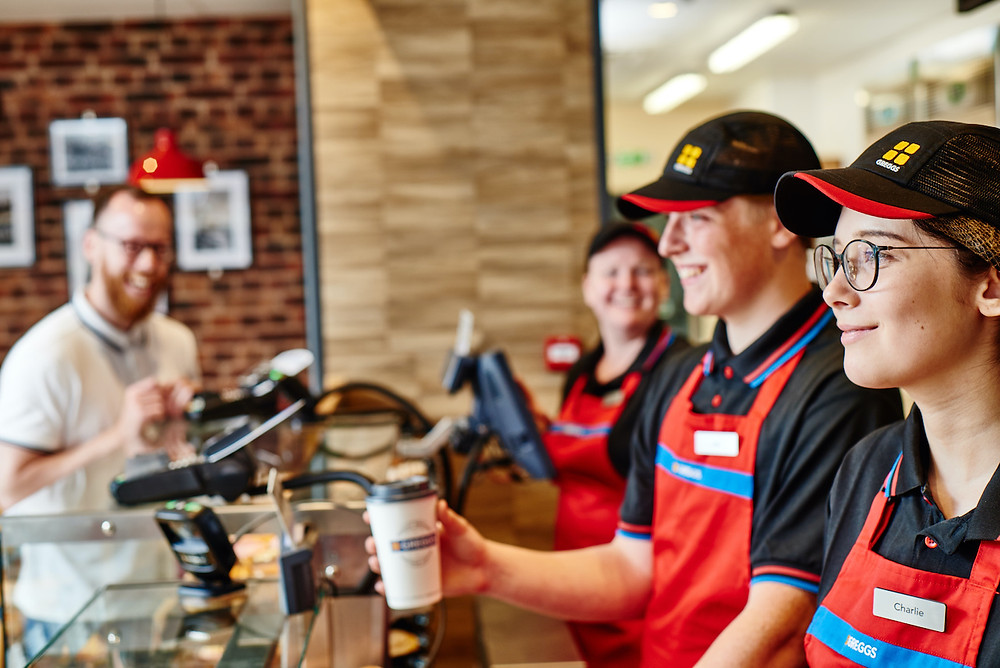 Staff serving a customer at Greggs