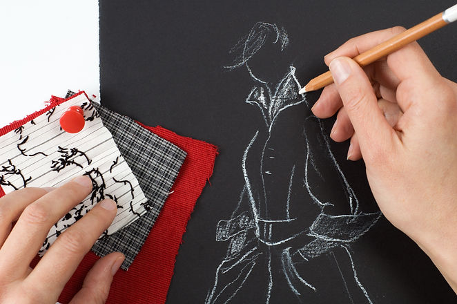 Fashion designer is drawing a fashion mo