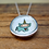 Thumbnail: Little Enameled Unicorn Heart Necklace by Mark Poulin