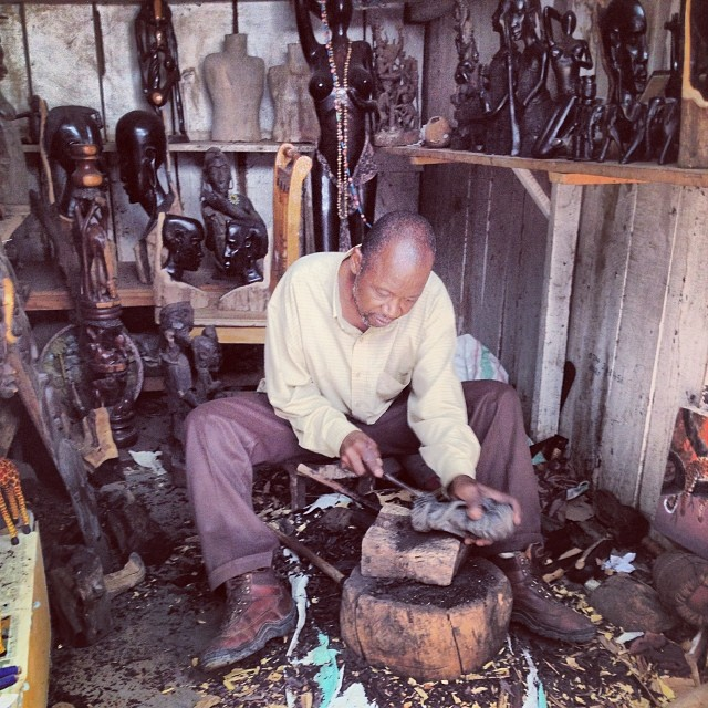 A man carving at the Maasai Market