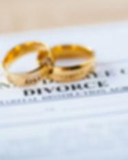Two broken golden wedding rings divorce