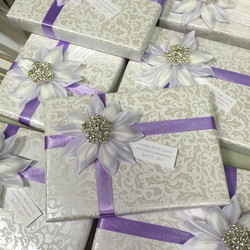 We are loving the combo of lavender on our new paisley paper with the brooch!! #bomboniere #favors #