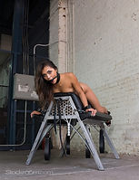 padded spanking bench by metal bound.jpg