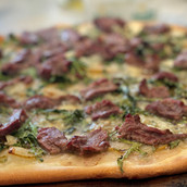 What do Steak, Pear & Arugula have in common? PIZZA