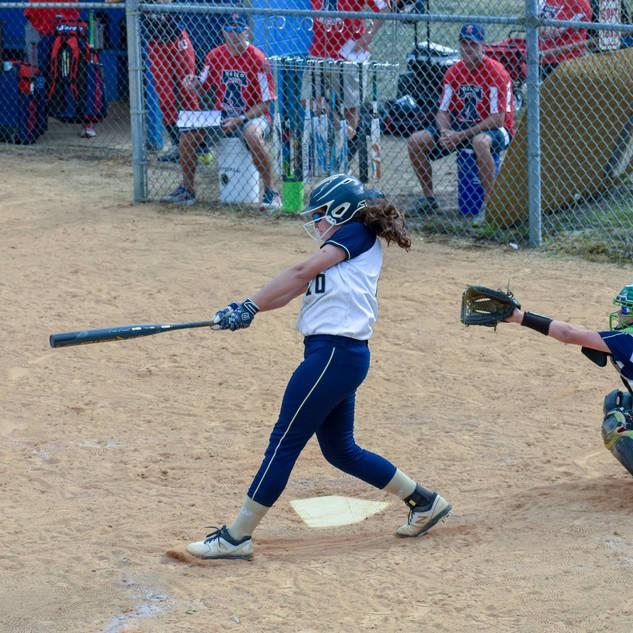 Violet Marta Hits a Long Fly Ball