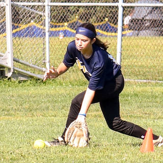 Ava Beal Fielding a Ground Ball in the Outfield