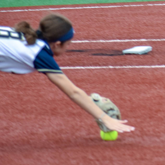 Ava Beal Dives for a Ball at First Base