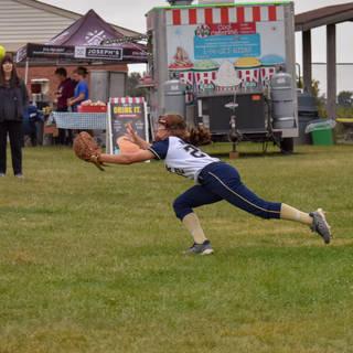 Jenna Morrison Dives for a Foul Ball Ball Aga