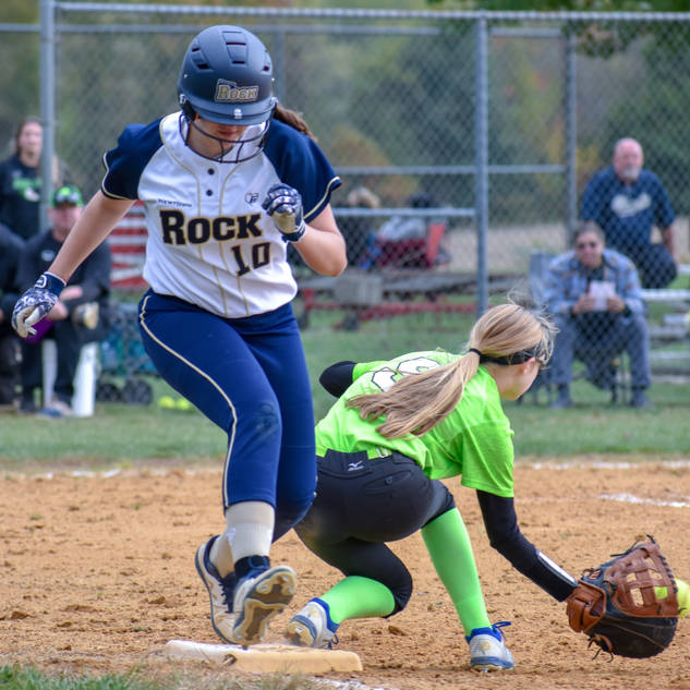 Violet Marta Beats Out a Throw to First