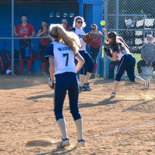 Abbey Throws to First on a Bunt