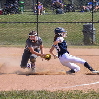 Katie Reed is Safe at Third Base Against