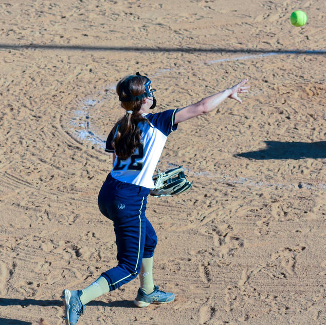 Jenna Morrison Throws to First