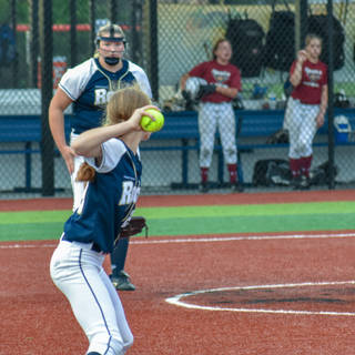 Katie Reed Looks to Throw Out the Base Runner