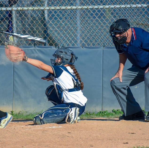 Abbey Valente Squeezes a Strike