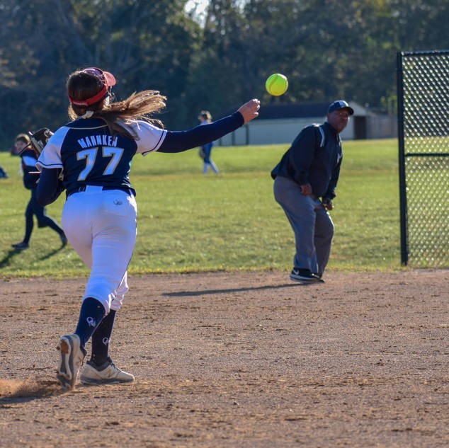 Ava Mahnken Makes the Throw to First Base