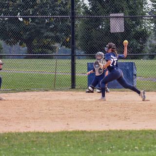 Ava Mahnken Makes a Throw to First