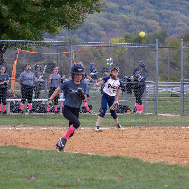 Alayna Throws to Emma at First Base
