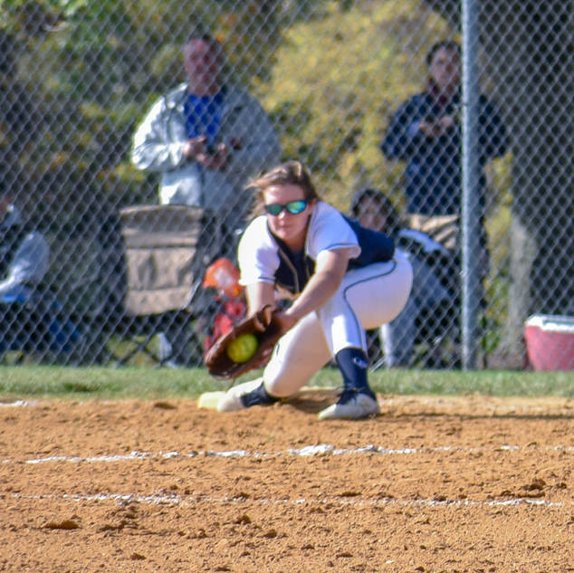Violet Marta Stretches to Make the Play at First