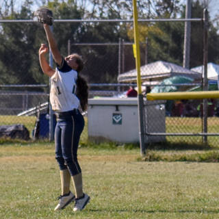 Abbey Valente Catches a Line Drive in the Out Field