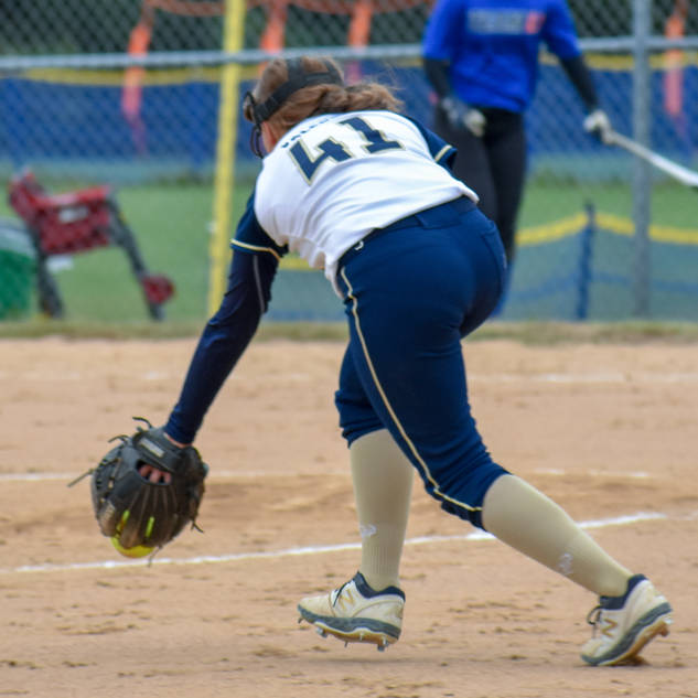 Abbey Valente Scoops up a Ground Ball