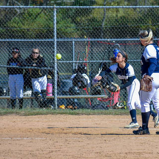 Alayna Throws to First Base