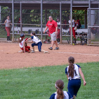 Abbey Throws a Runner Out at Third