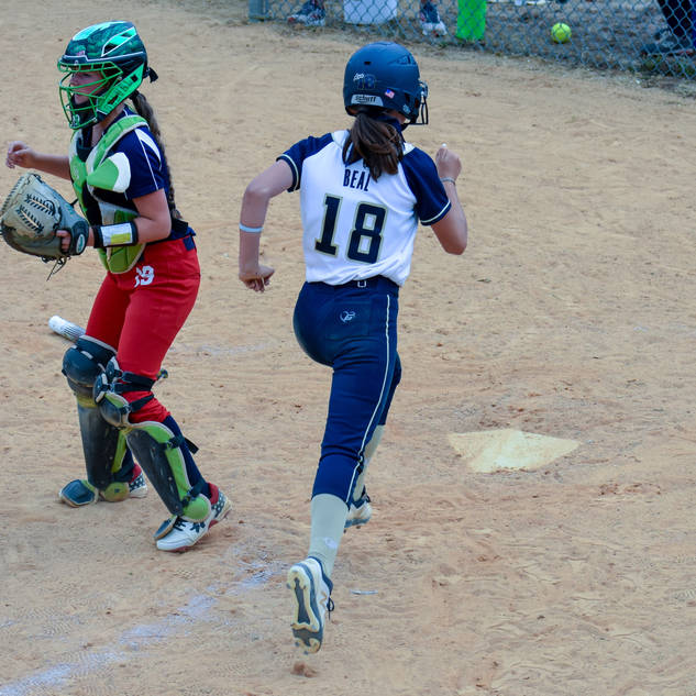 Ava Beal Scores a Run Against the Liberty