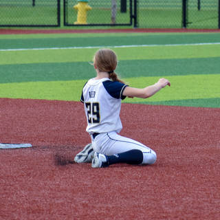 Katie Makes a Backhand Stop at Second