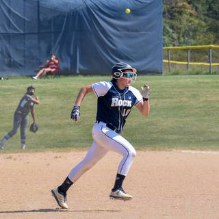 Violet Marta Beats the Throw to Third