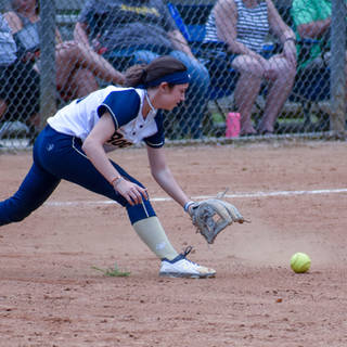 Ava Fields the Ball at First Base
