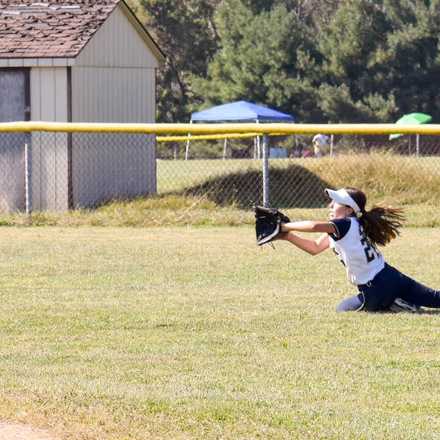 Angelina Dives for a Ball in Center Field