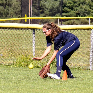 Violet Marta Fielding a Ground Ball in the Outfield