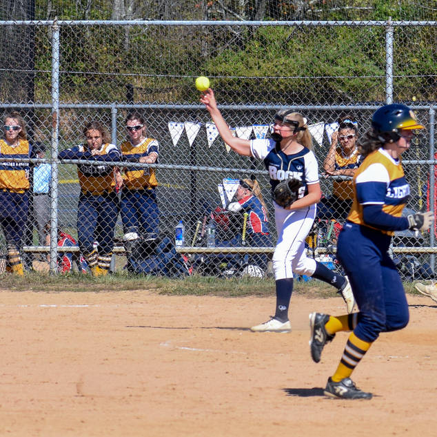 Emma Marchese Throws to First for the Out