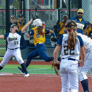 Emma Stretches to Make the Play at First