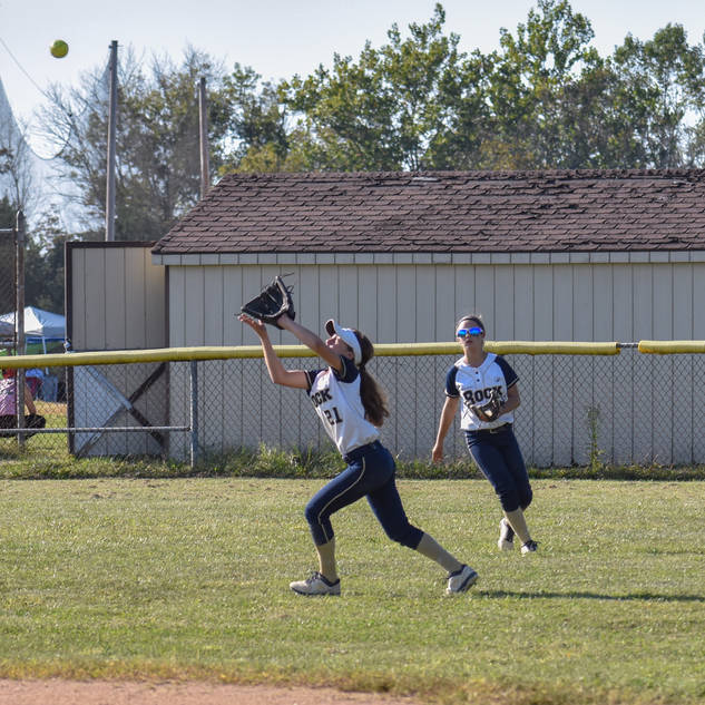 Angelina Benitez Chases Down a Fly Ball