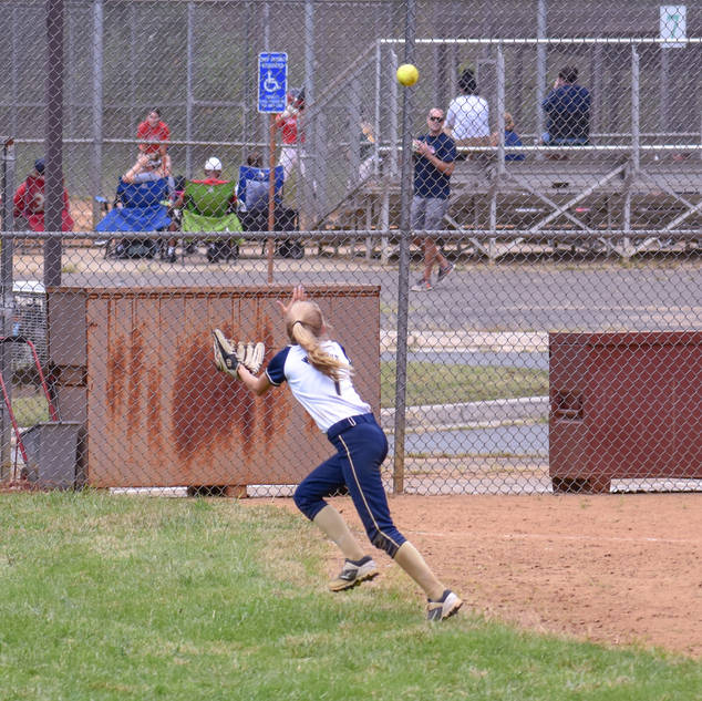 Helen Tracks a Ball Into the Out Field