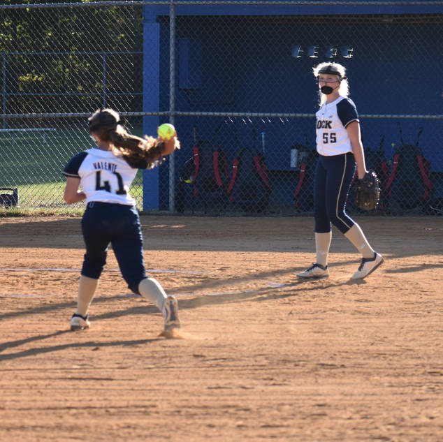 Abbey Valente Throws to First Base