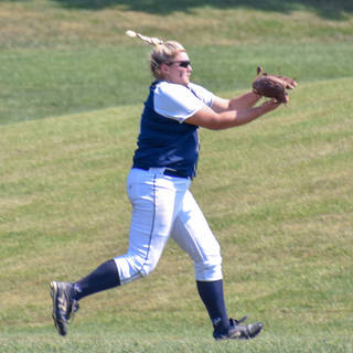 Kady Olsen Makes a Running Catch in the Outfield